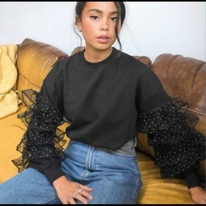 Sweater with organza frills in black